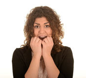 Frightened scared woman. Portrait of a frightened or scared woman with hands held to her open mouth as if she is screaming.  White background Stock Photo