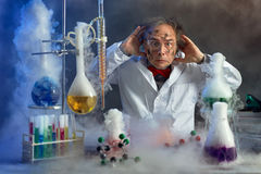 Frightened scientist front of experiment that exploded. In lab stock images