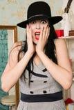 Frightened screaming retro model in the boudoir Stock Photo