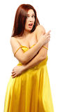 Frightened woman in yellow dress. Isolated on white background royalty free stock image