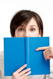 Frightened student girl with a book Royalty Free Stock Images