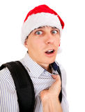 Frightened Teen in Santa Hat. Person threatens to Teenager in Santa Hat Isolated on the White Background Royalty Free Stock Images