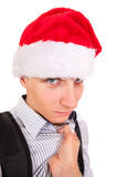 Frightened Teenager in Santa Hat. Person threatens to Teenager in Santa Hat Isolated on the White Background Royalty Free Stock Photo
