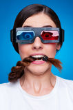 Frightened woman in 3d glasses. Watching blockbuster Royalty Free Stock Photo
