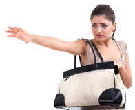 Frightened woman with bag Stock Photography