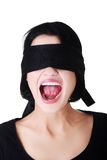 Frightened woman with black band on eyes Stock Photography
