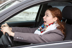 Frightened woman in car Stock Image