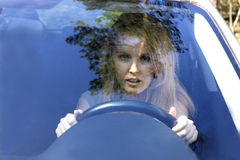 Frightened woman in car Royalty Free Stock Photos