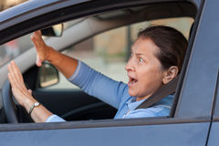 Frightened  woman in  car Royalty Free Stock Photography