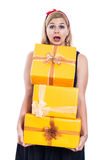 Frightened woman carrying presents Stock Photo
