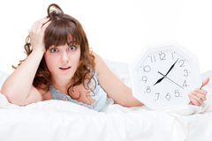 Frightened woman with clock Stock Images
