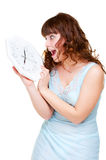 Frightened woman with clock Stock Image