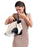 Frightened woman in dress looking to bag Royalty Free Stock Photography
