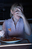 Frightened Woman Enjoying Meal Watching TV Royalty Free Stock Image