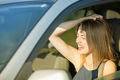 Frightened woman with her eyes closed and her mouth curved at. Afraid woman with a twisted mouth open and eyes closed behind the wheel of cars avtomomilya during royalty free stock image