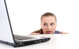 Frightened woman with laptop Royalty Free Stock Images