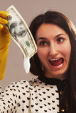 Frightened woman launder shady money (illegal cash, dollars bill. Corruption, manipulation Royalty Free Stock Images
