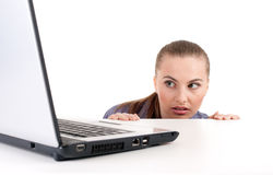Frightened woman looking on laptop Stock Photos