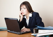 Frightened woman is looking at the laptop screen Royalty Free Stock Photo