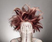 Frightened woman with messy hair. Hiding stock photos