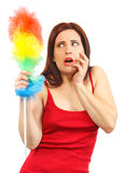 Frightened woman in red shirt with whisk for house dust Royalty Free Stock Photo