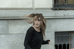 Frightened woman running away. On abandoned street stock images