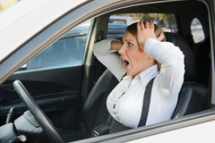 Frightened woman sitting in the car Royalty Free Stock Photos