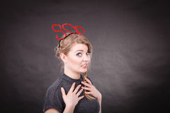 Frightened woman with sos help sign. Fear and fright. Young blonde terrified woman needs help. Frightened hopeless female with red sos sign symbol on dark Royalty Free Stock Photos