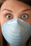 Frightened Woman with Surgical Mask Royalty Free Stock Photography