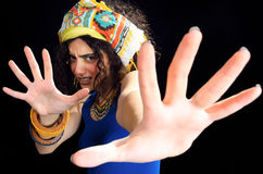 Frightened Woman. Wearing ethnic clothes and extending hands Stock Photos