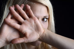 Frightened woman. Frightened young blond woman showing stop with two hands Royalty Free Stock Photography