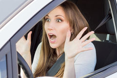 Frightened young car driver woman look straight Stock Photos
