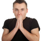 Frightened young man Stock Images