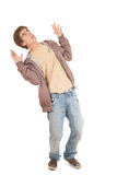 Frightened young man. In casual jacket, full length Stock Photography