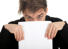 Frightened young man with blank card Stock Images