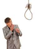Frightened young man and gallows Royalty Free Stock Photos