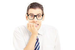 Frightened young man looking at camera Royalty Free Stock Images