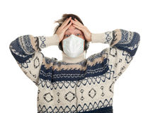 Frightened young man in protective mask Stock Images