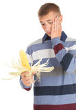 Frightened young man with raw corn, maize Royalty Free Stock Photos