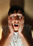 Frightened Young Man Stock Photography