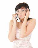 Frightened young woman on the phone Royalty Free Stock Photography