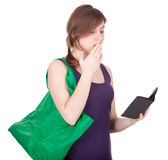 Frightened young woman with shopping bag Stock Photo