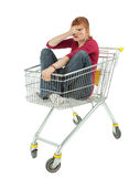 Frightened young woman sitting in shopping cart Stock Photos