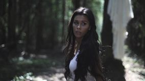 Frightened Young Woman Walk In The Forest stock video footage