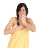 Frightened young woman in yellow towel Stock Photography