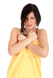 Frightened young woman in yellow towel Royalty Free Stock Image