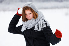 Frightening Attack from Cute Girl in Winter Royalty Free Stock Photography
