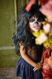 Frightening child. Eerie child looking at camera with frightening expression stock image