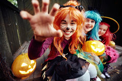 Frightening gesture. Halloween girl looking at camera with her hand in frightening gesture royalty free stock image