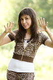 Frightening girl. Pretty brunette girl in frightening pose outdoors royalty free stock photos